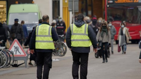 Long-Shot-of-Public-Service-Workers-Walking-Down-a-Busy-Street-In-Oxford-England
