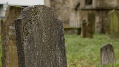 Panning-Shot-of-Tombstone-In-Graveyard-In-Oxford-England
