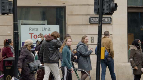 Long-Shot-of-People-On-Corner-of-George-Street-In-Oxford-England