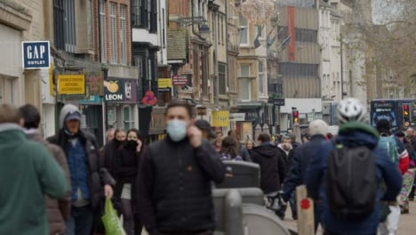 Long-Shot-of-a-Crowd-of-People-Walking-Down-Busy-Street-In-Oxford-England