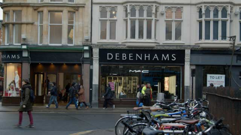 Wide-Shot-of-People-Walking-Past-Debenhams-Department-Store-In-Oxford-England