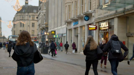 Tracking-Shot-of-People-Walking-Down-a-Busy-Street-In-Oxford-England