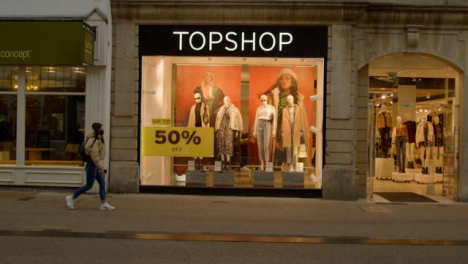 Wide-Shot-of-People-Walking-Past-TopShop-Store-In-Oxford-England