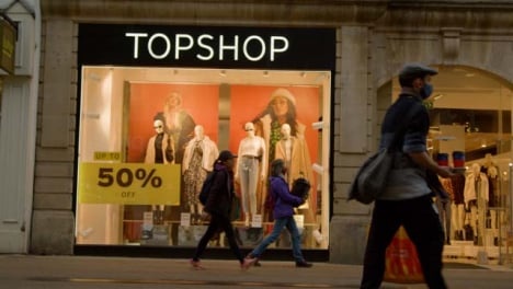 Low-Angle-Shot-of-People-Walking-Past-TopShop-Store-In-Oxford-England