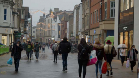 Wide-Shot-of-People-Walking-Down-a-Busy-Street-In-Oxford-England