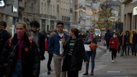 Long-Shot-of-People-Walking-Along-Busy-Street-In-Oxford-England