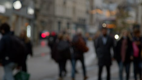 Defocused-Long-Shot-of-People-Walking-Along-Busy-Street-In-Oxford-England