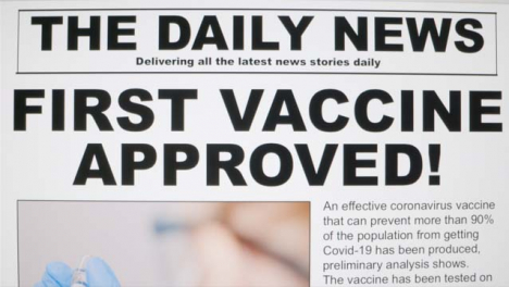 Dolly-Out-Extreme-Close-Up-Shot-of-Coronavirus-Vaccine-News-Article-On-Computer-Screen