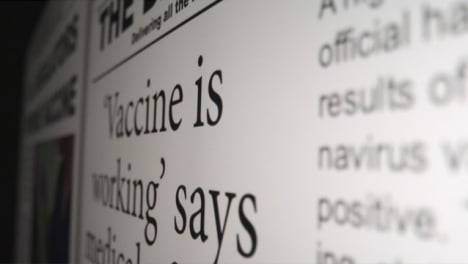 Sliding-Extreme-Close-Up-Shot-of-Covid-19-Vaccine-Article-On-Computer-Screen