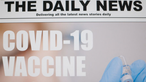 Close-Up-Shot-of-Scrolling-Covid-19-Vaccine-News-Article-Headline-On-Computer-Screen