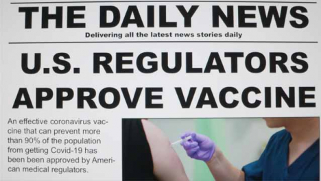Dolly-Out-Close-Up-Shot-of-Covid-19-Vaccine-Approval-News-Article-On-a-Computer-Screen