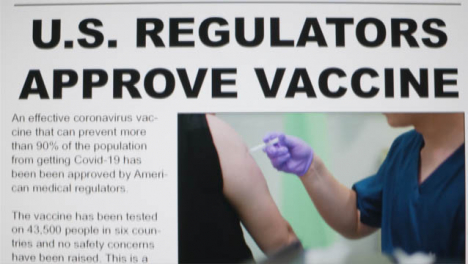 Close-Up-Shot-of-Scrolling-Covid-19-Vaccine-Approval-News-Article-On-a-Computer-Screen