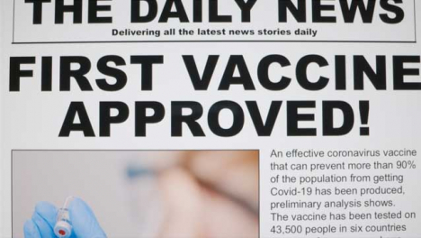 Dolly-Out-Close-Up-Shot-of-First-Covid-19-Vaccine-Approval-News-Article-On-a-Computer-Screen