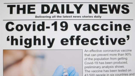 Dolly-Out-Close-Up-Shot-of-Effective-Covid-19-Vaccine-Approval-News-Article-On-a-Computer-Screen