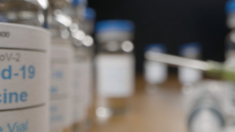 Sliding-Shot-Past-Covid-Vaccine-Vials-to-Extreme-Close-Up-of-Single-Vial