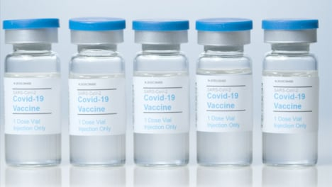 Sliding-Close-Up-Shot-of-Five-Vials-of-Covid-Vaccine-