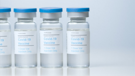 Sliding-Close-Up-Shot-of-Five-Vials-of-Covid-19-Vaccine-