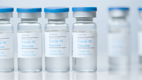 Sliding-Close-Up-Shot-of-Five-Vials-of-a-Covid-19-Vaccine-