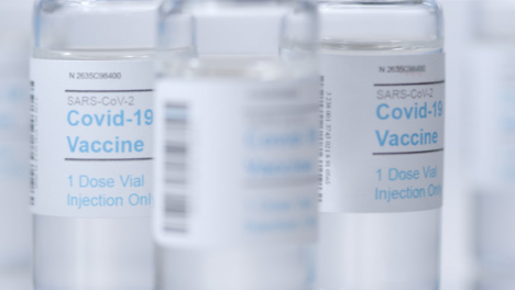Sliding-Extreme-Close-Up-Shot-Past-Multiple-Vials-of-Covid-19-Vaccine