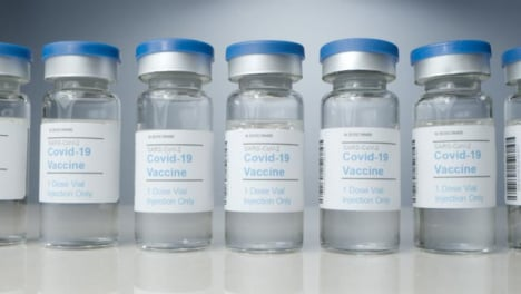 Sliding-Close-Up-Shot-of-Vials-of-Covid-19-Vaccine