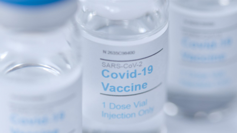 Sliding-Extreme-Close-Up-Shot-of-Several-Covid-19-Vaccine-Vials-