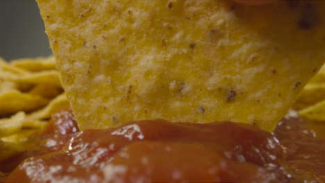 Sliding-Extreme-Close-Up-Shot-of-Nacho-Being-Dipped-Into-Sauce-