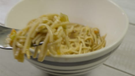 Sliding-Extreme-Close-Up-Shot-Approaching-a-Bowl-of-Noodles