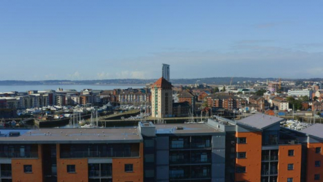 Drone-Shot-Rising-Over-Apartment-Building-Revealing-Swansea-Marina-01