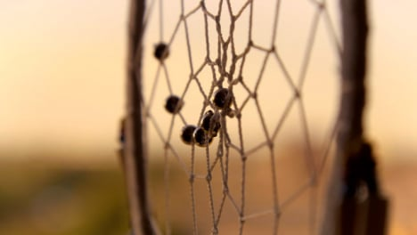 Extreme-Close-Up-Shot-of-Dreamcatcher-Web-Spinning-In-the-Wind