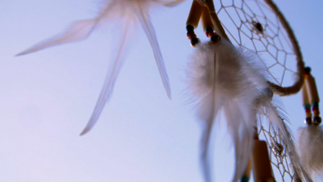 Close-Up-Shot-of-Dreamcatcher-Spinning-In-the-Wind