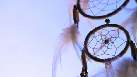Close-Up-Shot-of-a-Dreamcatcher-Spinning-In-the-Wind