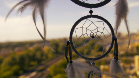 Close-Up-Shot-of-a-Dreamcatcher-Swaying-In-the-Wind