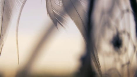 Extreme-Close-Up-Shot-of-a-Dreamcatcher-Swaying-In-the-Wind