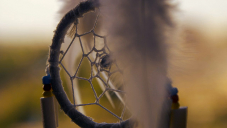 Extreme-Close-Up-Shot-of-Dreamcatcher-Swaying-In-the-Wind
