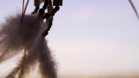Extreme-Close-Up-Shot-of-Dreamcatcher-Feathers-Swaying-In-the-Wind