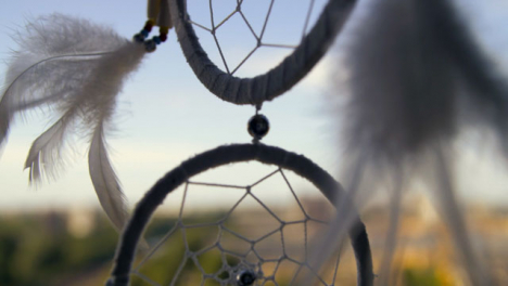 Extreme-Close-Up-Shot-of-Dreamcatcher-Rotating-In-the-Wind
