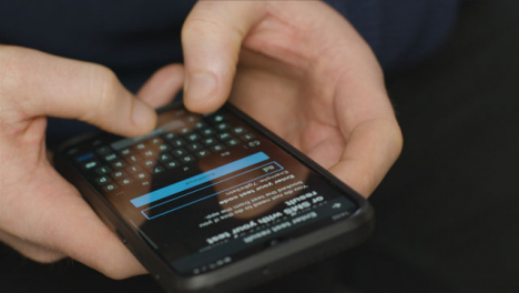 Close-Up-of-Hands-Using-Coronavirus-Lockdown-Smartphone-Application