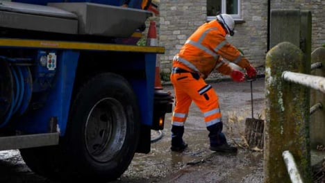 Handheld-Shot-of-Drainage-Worker-Pulling-Up-Strom-Drain-Cover-