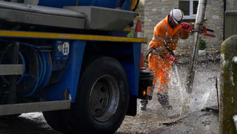 Handheld-Shot-of-Drainage-Worker-Using-High-Pressure-Hose-to-Clear-Out-Blocked-Drain