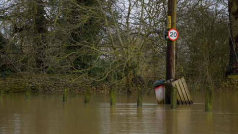 Long-Shot-of-Submerged-Electrical-Pole-In-Flooded-Road-