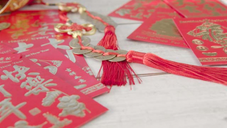 Sliding-Close-Up-Shot-of-Pile-of-Chinese-New-Year-Red-Envelopes