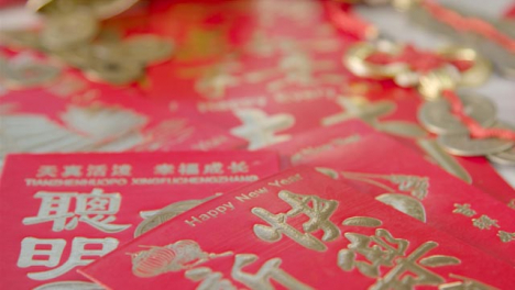 Sliding-Close-Up-Shot-of-a-Pile-of-Chinese-New-Year-Red-Envelopes