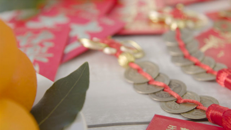 Sliding-Close-Up-Shot-of-Pile-of-Chinese-New-Year-Red-Pockets