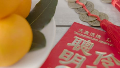 Sliding-Close-Up-Shot-of-a-Pile-of-Chinese-New-Year-Red-Pockets