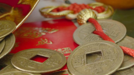 Sliding-Macro-Shot-of-Over-Pile-of-Chinese-New-Year-Red-Pockets