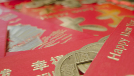 Sliding-Macro-Shot-of-Over-Pile-of-Chinese-New-Year-Red-Packets