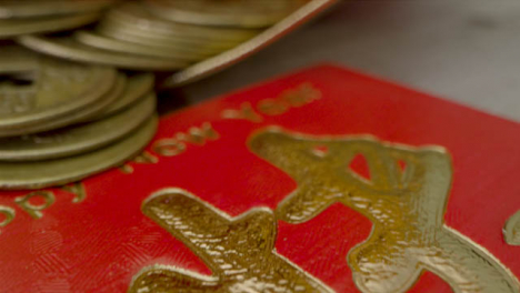 Sliding-Macro-Shot-of-Chinese-New-Year-Red-Envelopes-and-Coins