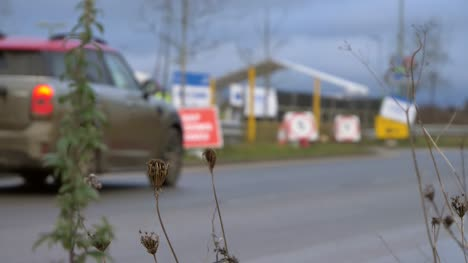 Defocused-Wide-Shot-of-Car-Driving-Into-COVID-Testing-Site