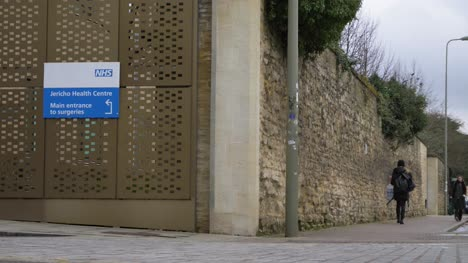 Low-Angle-Wide-Shot-of-Jericho-Health-Centre-Sign-In-Oxford