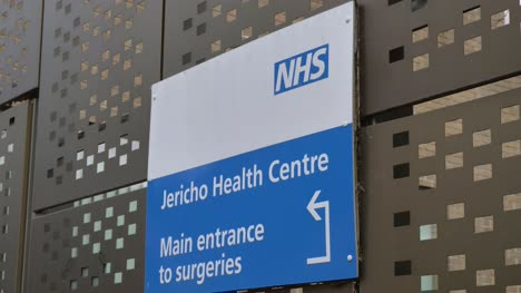 Handheld-Close-Up-Shot-of-the-Jericho-Health-Centre-Sign-